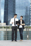 Asian Business man and woman using a Laptop Royalty Free Stock Photos