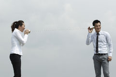 Asian Business man and woman using Tin Can Phone. Royalty Free Stock Images
