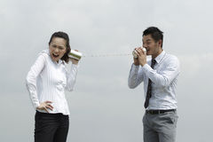 Asian Business man and woman using Tin Can Phone. Stock Images