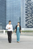 Asian Business Man and Woman Walking Royalty Free Stock Photos