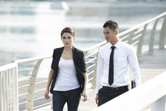 Asian Business Man and Woman Walking Stock Photos