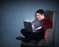 Asian business man working with laptop Stock Image