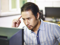 Asian business man working in office Stock Images