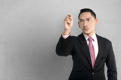 Asian Business Man Write Something Royalty Free Stock Images