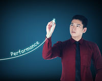 Asian business man writing performance Royalty Free Stock Images