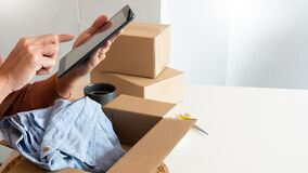Free Asian Business Owner Working At Home With Packing Box Of His Online Store Prepare To Deliver Products To Customers, Alpha Stock Photo - 215664650