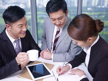 Asian business people. At a meeting Royalty Free Stock Photography