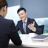 Asian business people. Asian business executives having a discussion in office Royalty Free Stock Image