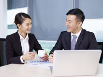 Asian business people. Asian business executives taking a break during meeting Stock Photo