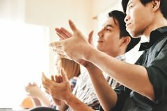 Asian business people clapping hands. Asian business people clapping hands at conference. Meeting, seminar concepts stock image