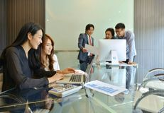 Asian business people discussing with each other royalty free stock image