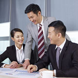 Asian business people. Discussing business in office Stock Photography