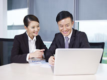 Asian business people. Discussing business in office Royalty Free Stock Photography