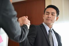 Asian Business people Handshake. Asian Business people Handshake at meeting Royalty Free Stock Image