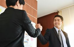 Asian Business people Handshake at meeting. Selective focus on hands Royalty Free Stock Photography