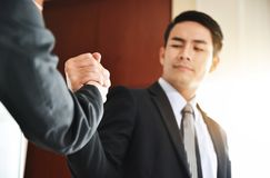 Asian Business people Handshake at meeting. Selective focus on hands Stock Photos