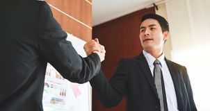 Asian Business people Handshake at meeting. Selective focus on hands Stock Photography