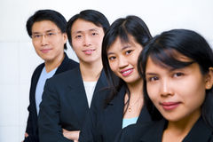 Asian business people line up royalty free stock photo