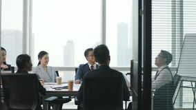 Asian business people meeting in conference room