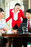 Asian business people meeting in hotel lobby Royalty Free Stock Image
