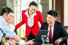 Asian business people meeting in hotel lobby Royalty Free Stock Photography