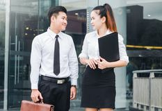 Asian business people meeting and using digital tablet outdoor after work royalty free stock photo