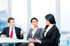 Asian Business people in office team meeting Stock Photo