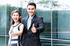 Asian business people outside in front of building Royalty Free Stock Photo