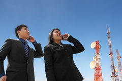 Asian business people on phone and antenna Royalty Free Stock Images