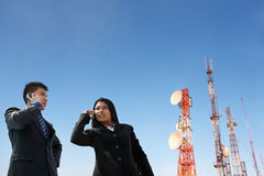 Asian business people on phone and antenna Stock Photos