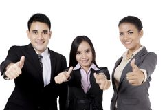 Asian business people showing thumbs up Stock Images