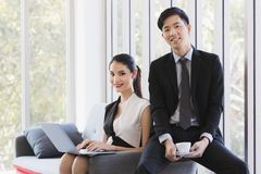 Asian business people posing in office royalty free stock image