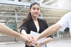 Asian business people stacking hands together. Successful and teamwork concept. stock photography