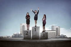 Asian business people standing on the podium Royalty Free Stock Photography