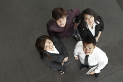 Asian Business people standing together looking up Royalty Free Stock Images