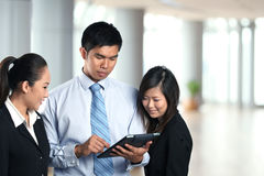 Asian Business people using a digital touch pad Stock Photos