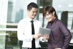 Asian Business people using Touch-pad PC Stock Photo