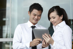 Asian Business people using Touch-pad PC Royalty Free Stock Photo