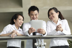 Asian Business people using Touch-pad PC Stock Photos