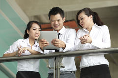 Asian Business people using Touch-pad PC Royalty Free Stock Images