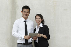 Asian Business people using Touch-pad PC Stock Images