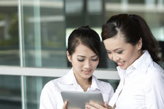 Asian business people using touch-pad tablet Stock Photos
