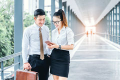 Asian Business people walking and talking outside office. Stock Photo