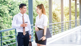 Asian Business people walking and talking outside office. Royalty Free Stock Image