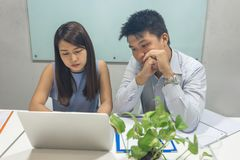 Asian business people working together on laptop stock image
