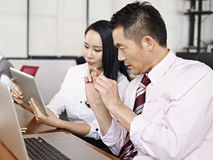 Asian business people working together Stock Photo