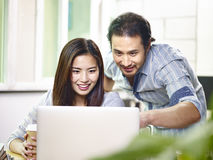 Asian business people working together in office stock photography