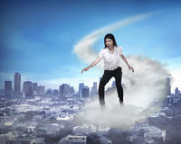 Asian business person flying with the cloud Royalty Free Stock Images