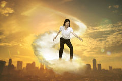 Asian business person flying with the cloud Royalty Free Stock Photo