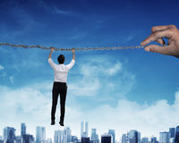 Asian business person hanging on chain Royalty Free Stock Photography